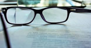 Glasses on papers